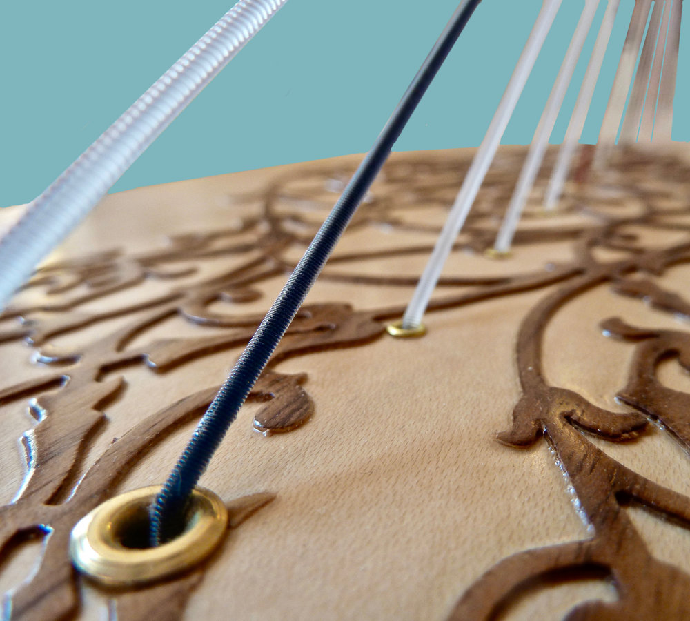 A Rees poplar soundboard with a maple veneer and walnut ornamentation.