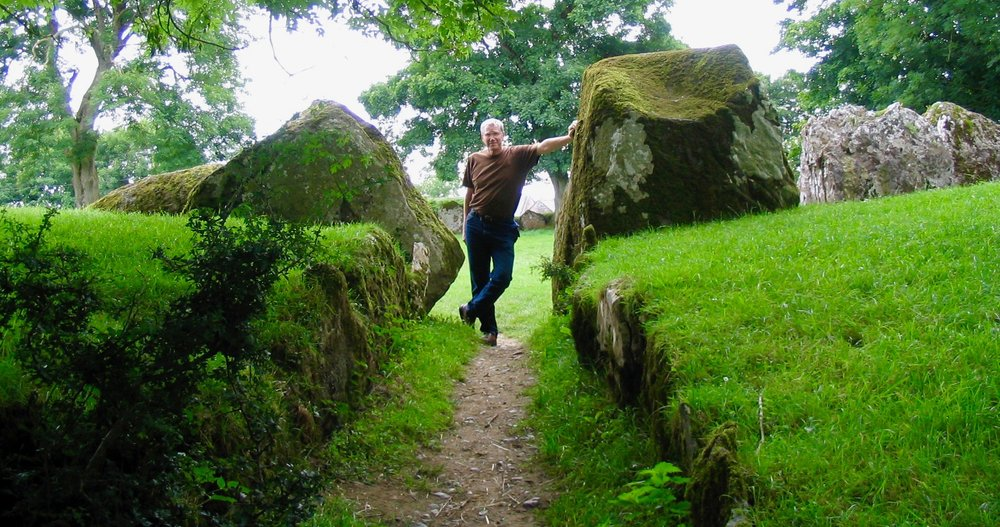 Luthier William Rees at a stone circle in Ireland where the weather, for harps, is usually temperate.
