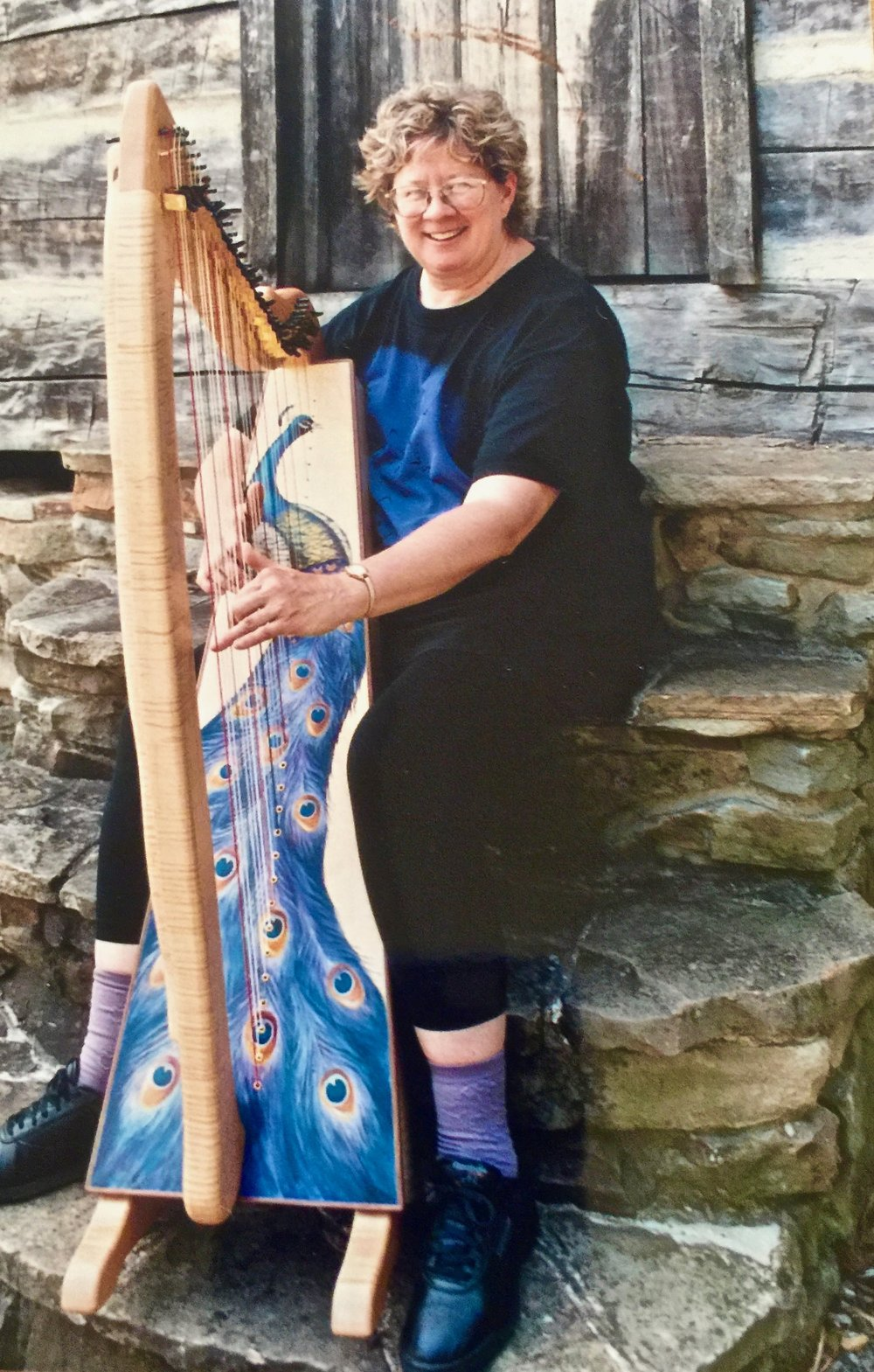 Carol Thompson with her one-of-a-kind peacock Glen Aulin Harp.