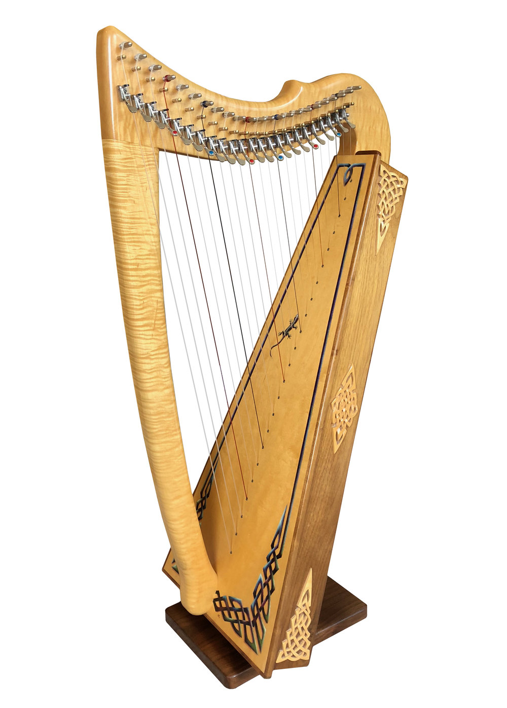 Rees Morgan Meadow in flamed maple and walnut with optional custom ornamentation and full Rees sharping levers. (This is Garen Rees' personal harp.)