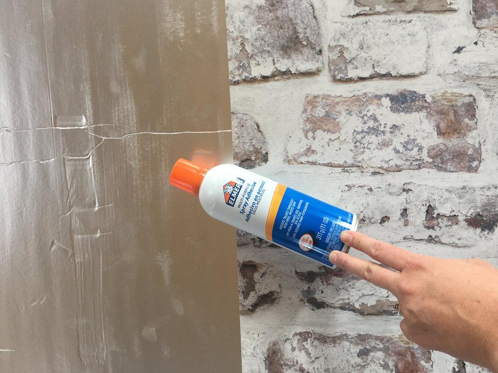 Using proper wallpaper adhesive... or Elmer's Glue.