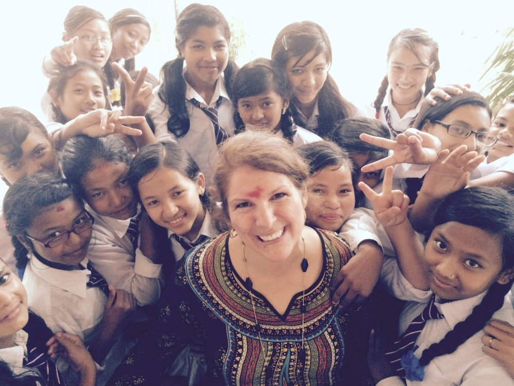 Celeste Mergens, founder of Days for Girls, with girls in Nepal.