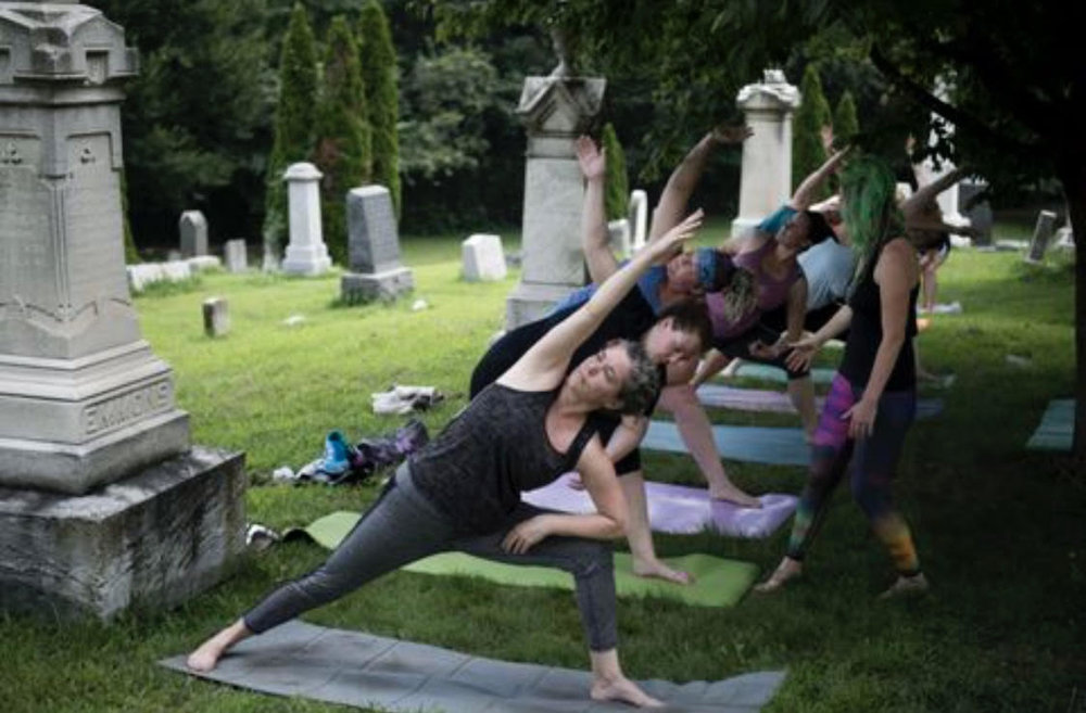 """Kelly Carnes teaches """"Yoga Mortis,"""" a free, bimonthly yoga class at Congressional Cemetery. Photo by Carolyn Van Houten / The Washington Post."""