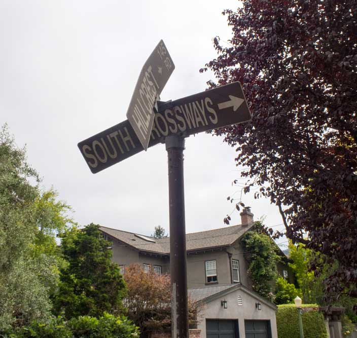 South Crossways has signs indicating both its name and its cross street, but vandals have damaged both.
