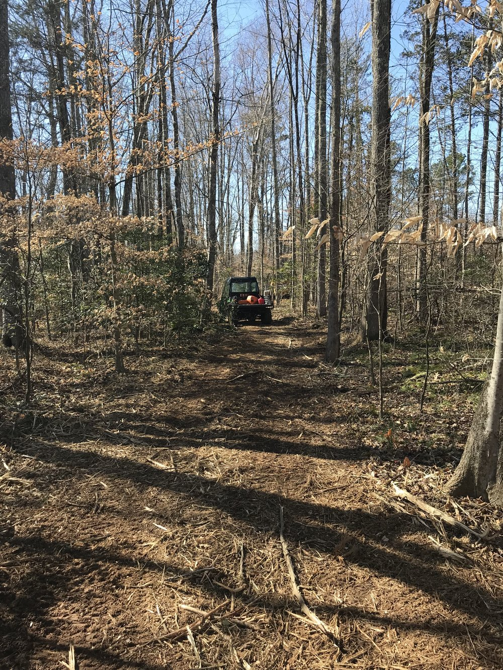Cutting Trails in Chilesburg, VA with our modified CAT 297 and Gator 855D support vehicle