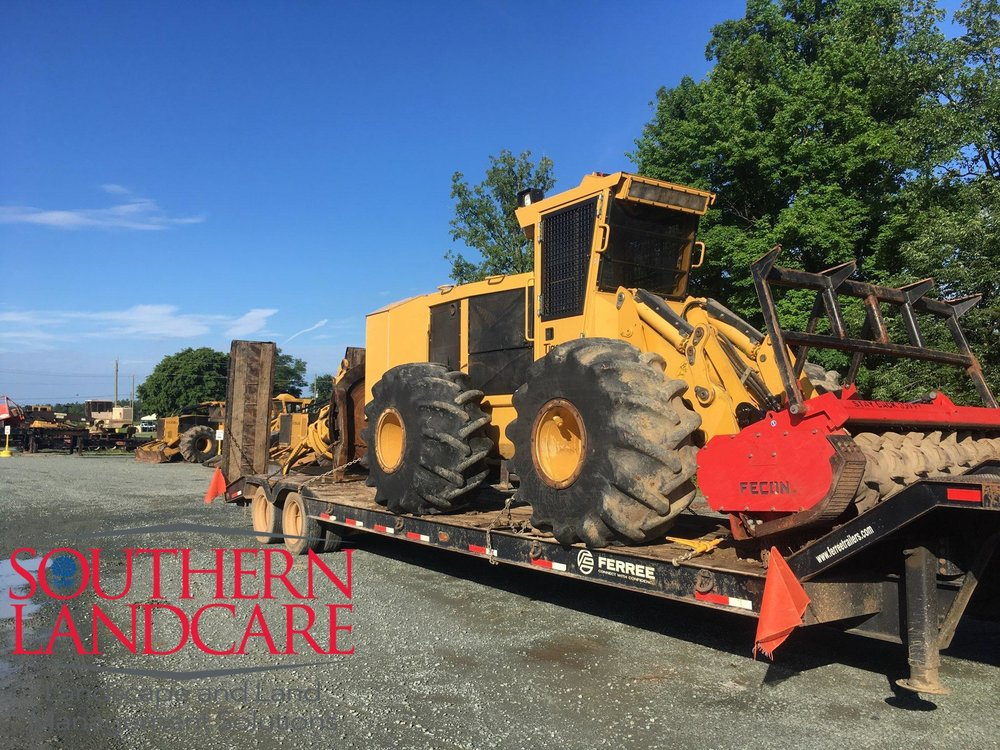 TigerCat 760 site prep tractor with Fecon forestry mulcher head mounted ready to transport to Charlottesville, VA