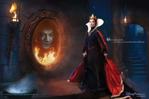 "The image, an ad for Disney's theme parks, shows actress Olivia Wilde as the evil queen in Disney's ""Snow White"" and Alec Baldwin as the mirror"