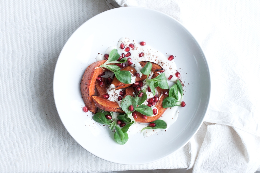 Roasted Red Kuri Squash with Sumac, Pomegranates and Greens recipe - The Little Plantation