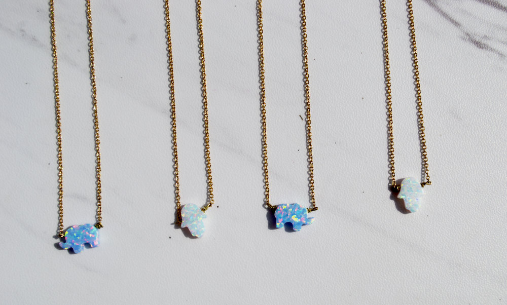 O P A L S $30 Handmade. Opal Elephant in blue or Opal Hamsa Hand in white. 14kt gold filled. Nickel-free. Please   contact me   to shop this item.
