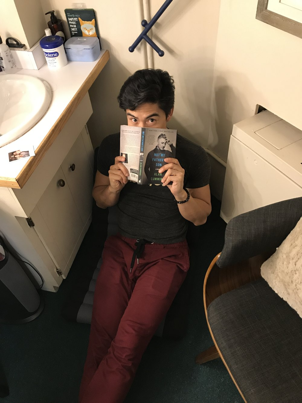 The handsome actor in his reading nook.