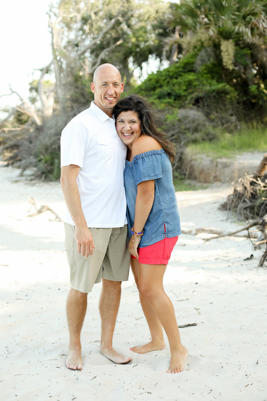 Happy couple smiling on Driftwood Beach, Jekyll Island, GA