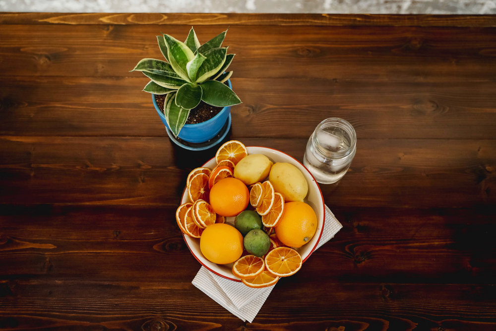 Table top dried oranges featuring linens from Dot & Army