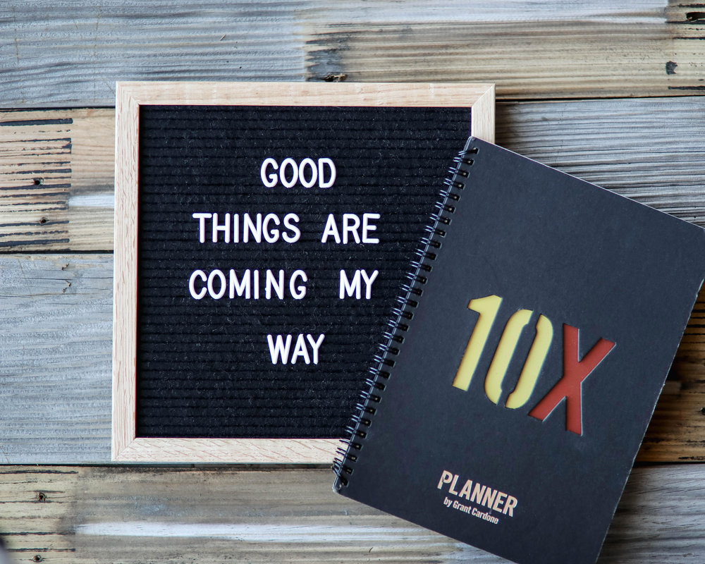 """Letterboard that says, """"good things are coming my way"""" next to a planner"""