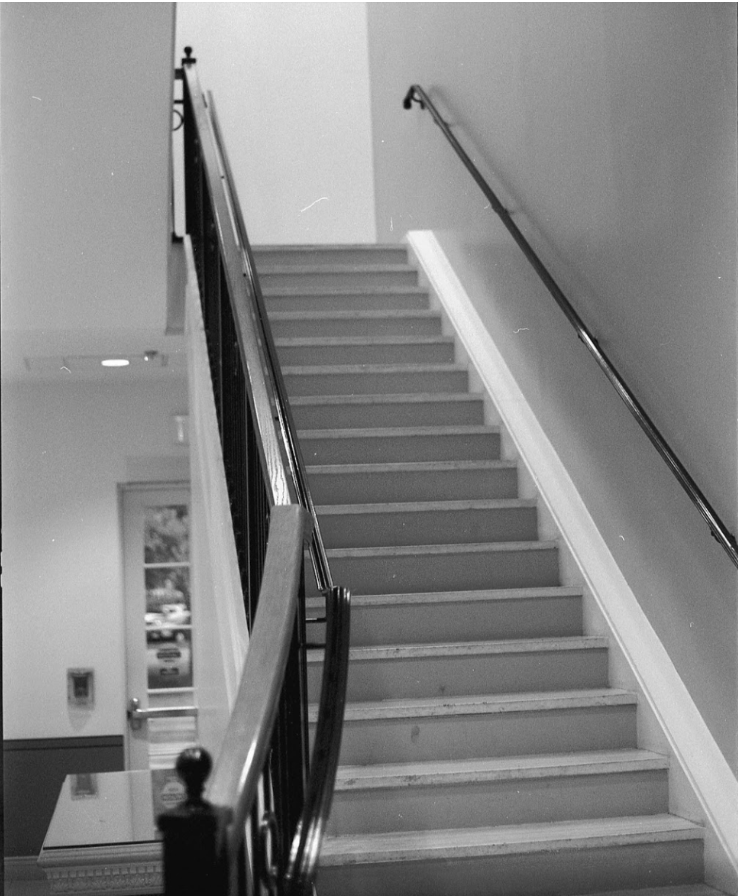 Participant 17, Photo 1: Stairwell  Feeling of one more step towards the window. Feeling a bit aimless after the semester, with the structure of it all ending. I have a lot of fear around taking finals and what happens after them.