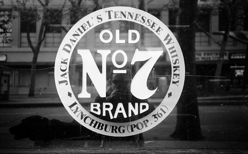 Old No. 7 Brand sign in a window, San Jose, California.