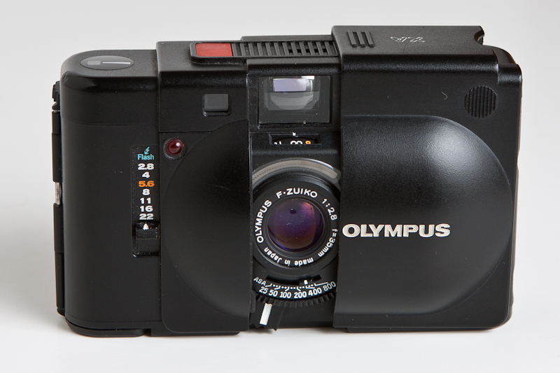 A photograph of an Olympus XA 35mm Camera with clamshell open