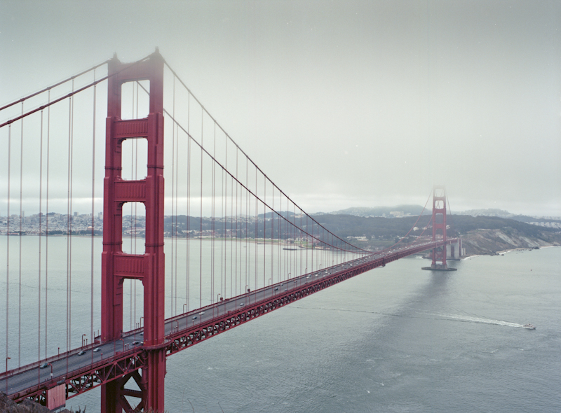 A photograph of the Golden Gate Bridge with the city of San Francisco in the background taken from the Marin Headlands