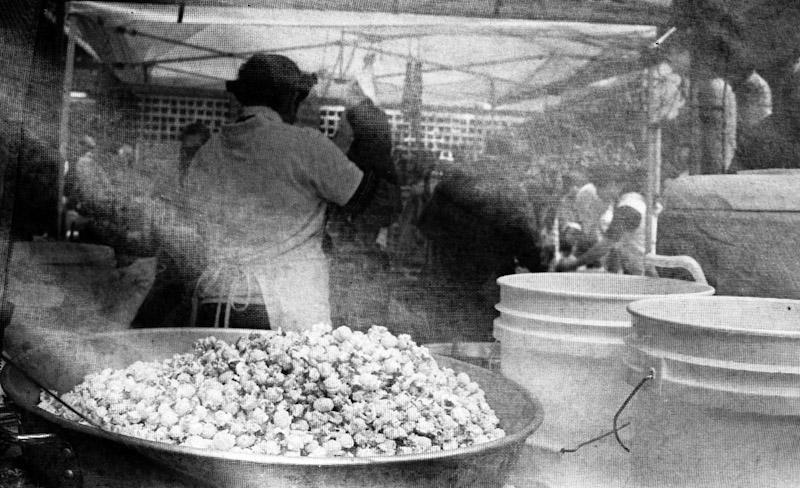 A photograph of someone making kettle korn
