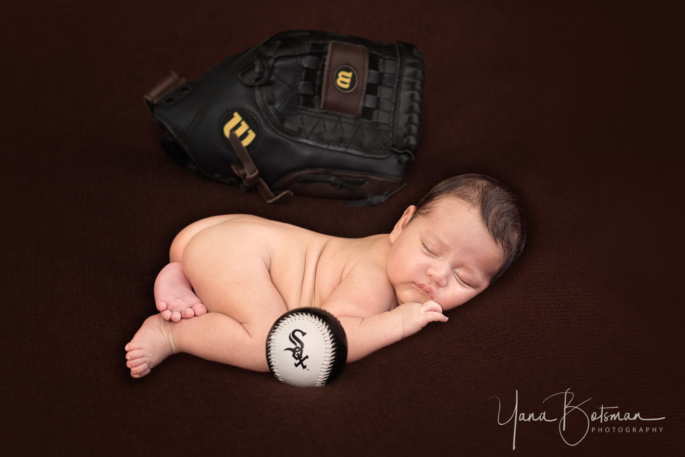 newborn baby with baseball glove and ball.jpg