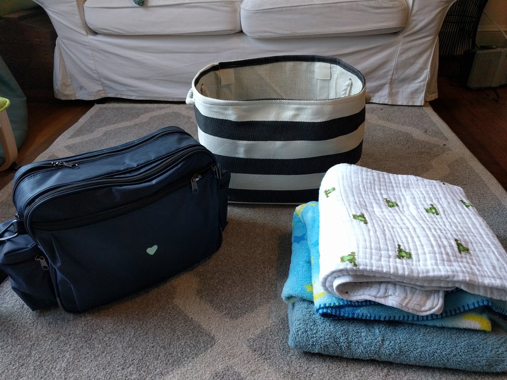 From left to right: Medical bag, basket for transportation of cats and smaller dogs, some of the blankets used for covering pets during transportation