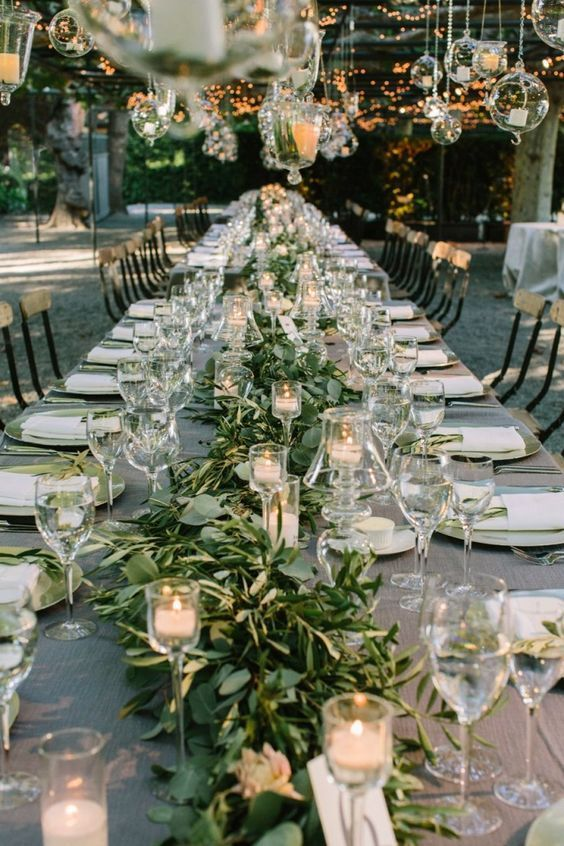 Greenery as a table wedding centerpiece. Photo by The Edges Wedding Photography via Pinterest