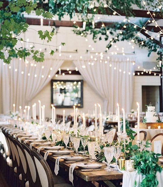 Greenery garland as decor for a wedding reception. Via  Pinterest .