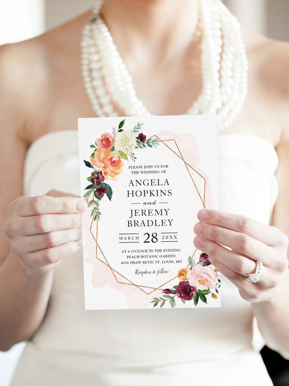 Spring wedding invitation with florals via  Pinterest .