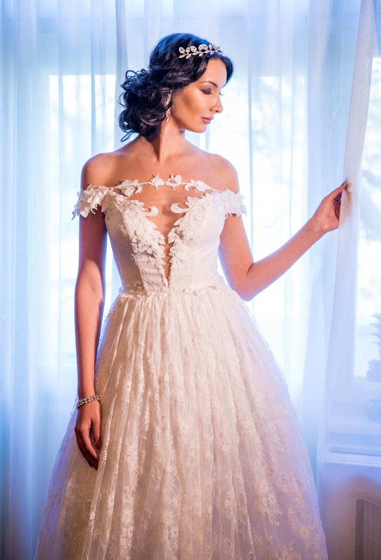 Featured:  Cameline , A-line ivory wedding dress with illusion plunging V neckline and floral lace