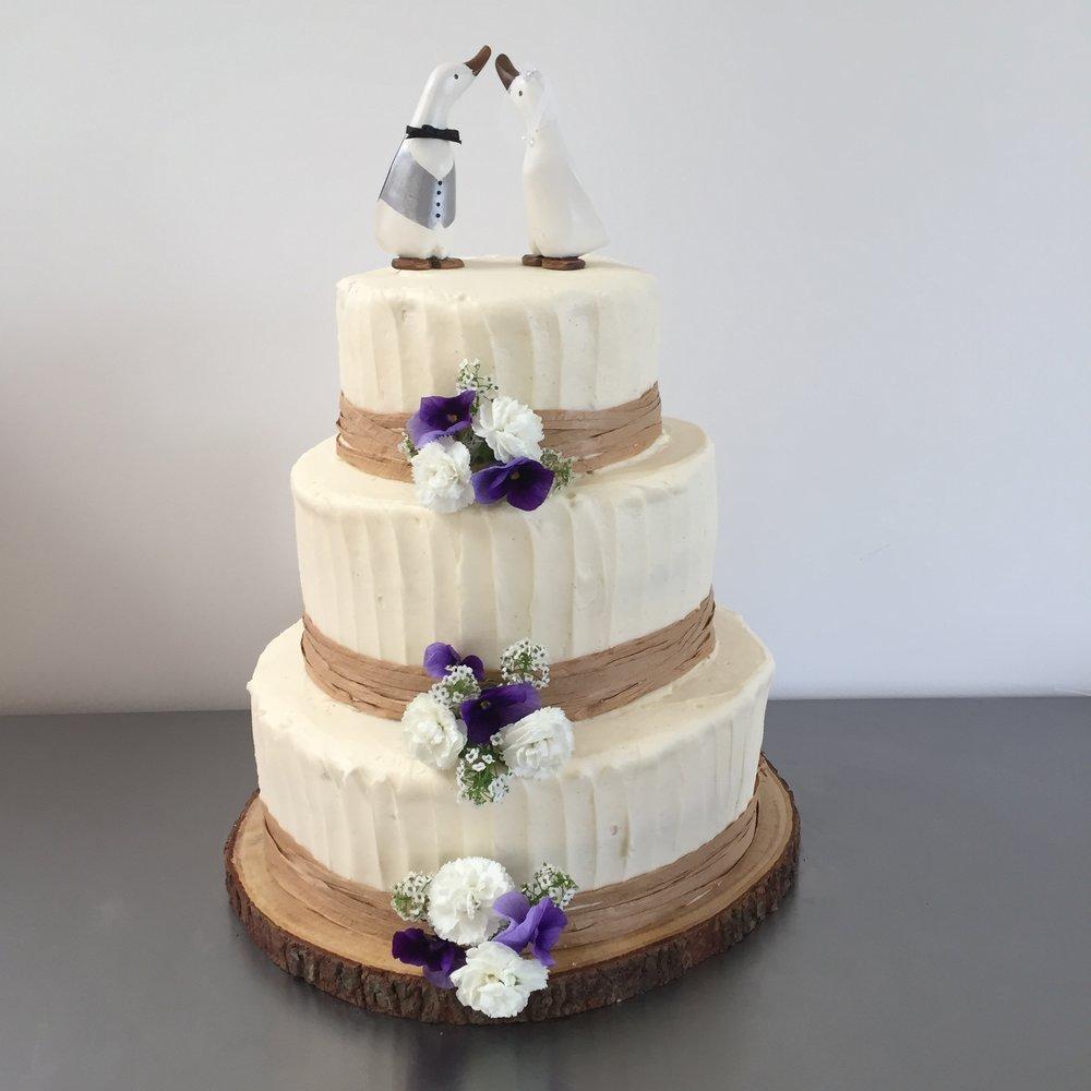 Wedding cake with fresh flowers in Norfolk