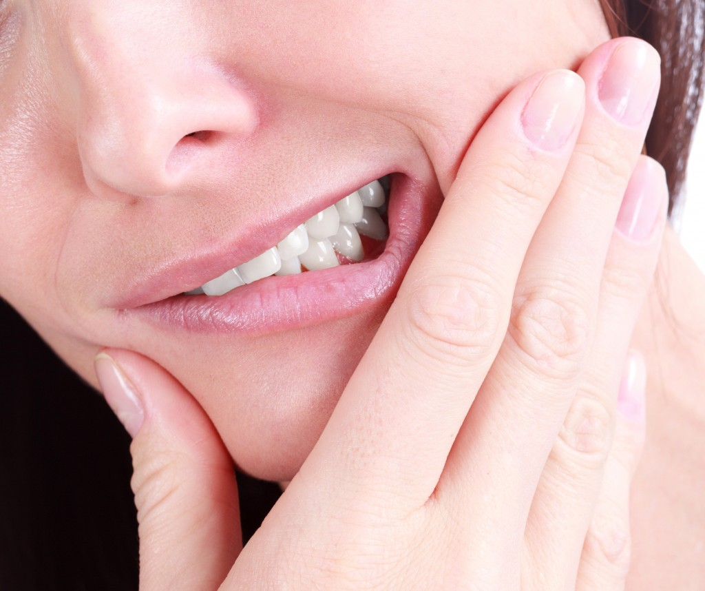 A woman with tooth pain