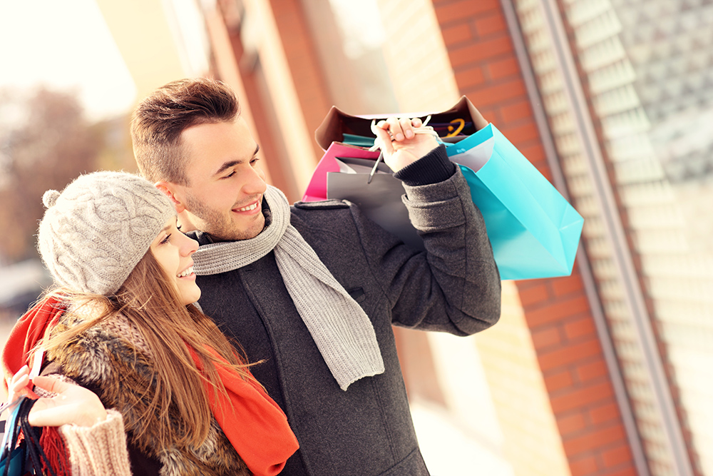 Couple enjoying retail therapy shopping in Brookline, MA
