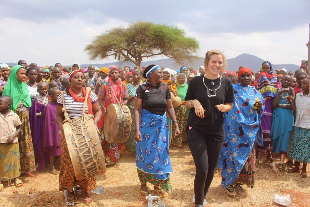 Caroline on her way to the ceremony site with the parade of song and dance.
