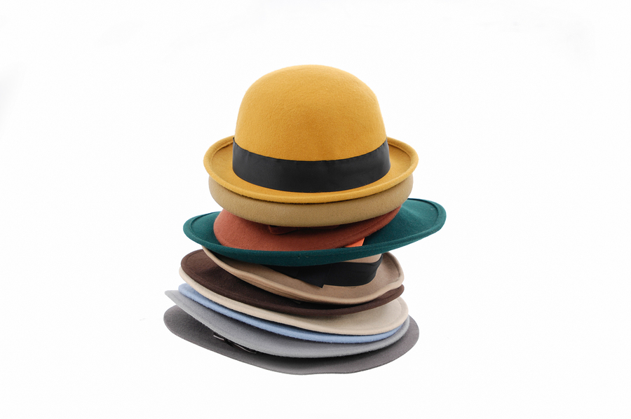 bigstock-Stacked-of-many-woman-hat----168023384.jpg