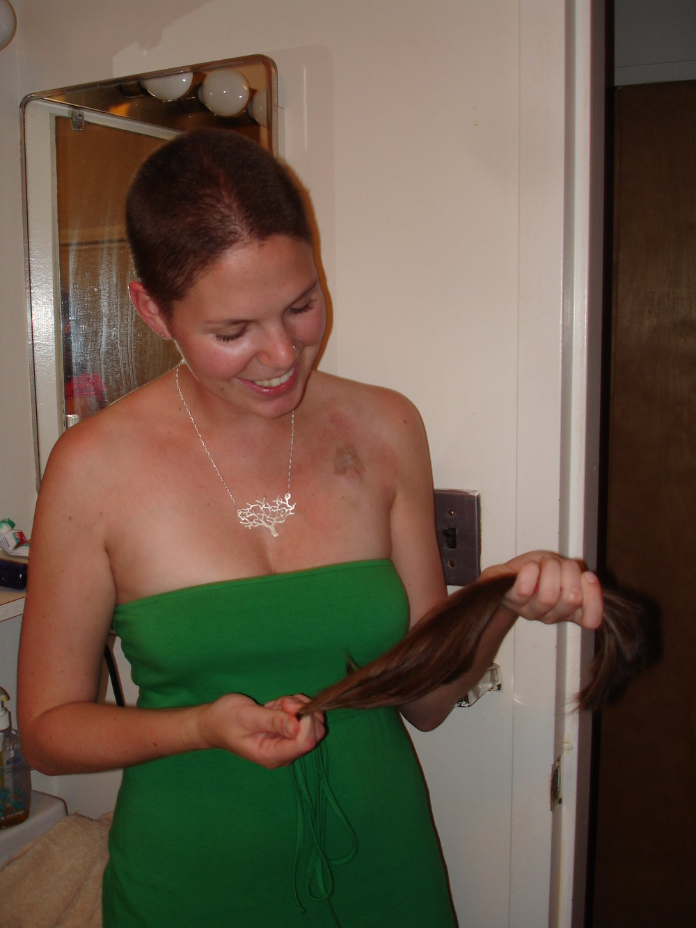 This was taken the night of my head-shaving party where I was surrounded by the sweetest friends. I had just had surgery to insert a chemotherapy port in my chest a few days earlier. I knew I would lose my hair as a result of the chemotherapy side effects and I knew I would feel more empowered if we celebrated the moment. I donated my hair afterwards.