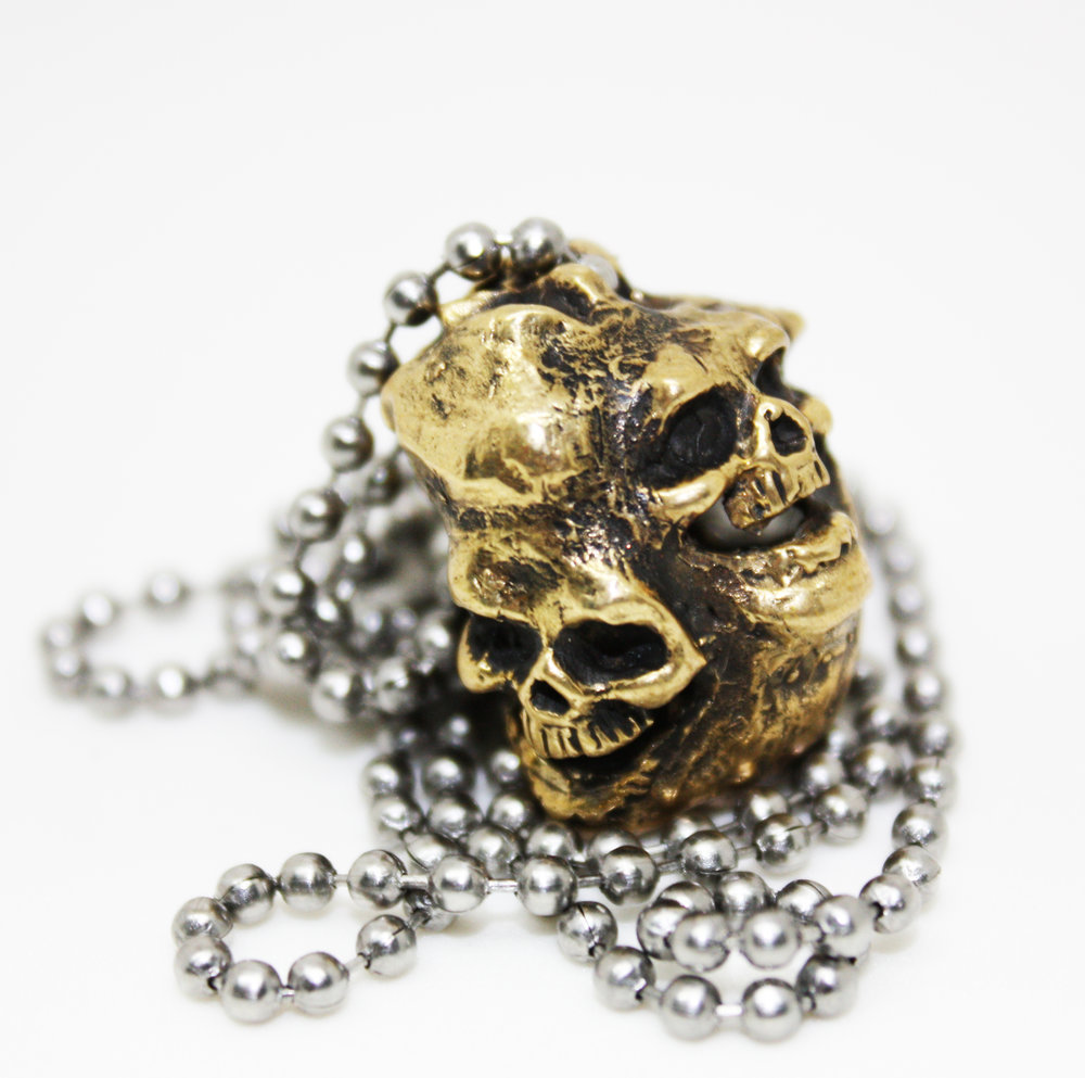 Laughing Skulls Pendant - Bronze