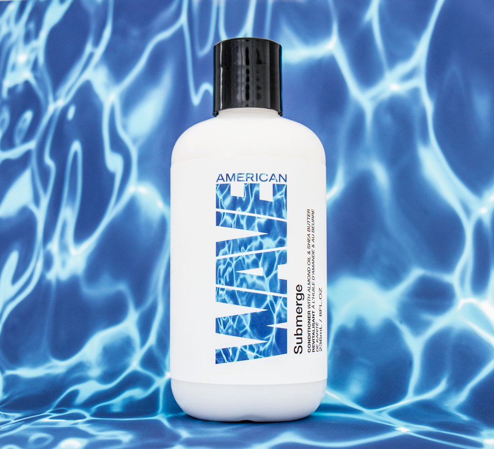 Submerge Submerge detangles and softens textures with a blend of botanicals and oils. Makes waves and curls easier to manage and control with a nourishing moisture mix to keep away frizz. Creates bounce, shape and lots of sheen. Protects the hair from cortex to cuticle. Encourages curl expansion; never adds weight.