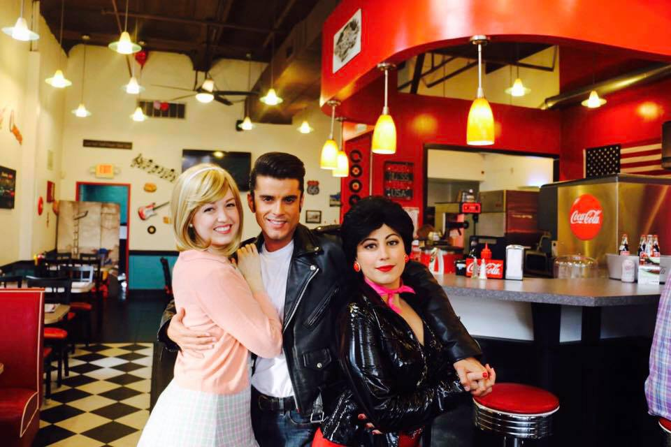 Lucy Shea (far left) as Sandy in Grease