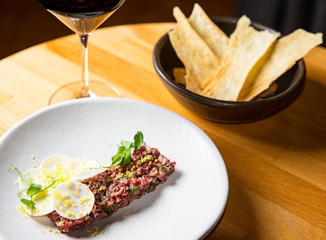 It's finally feeling like spring!  Perfect weather to linger over a grass-fed steak tartare and a glass of wine! 📸: @fooderator