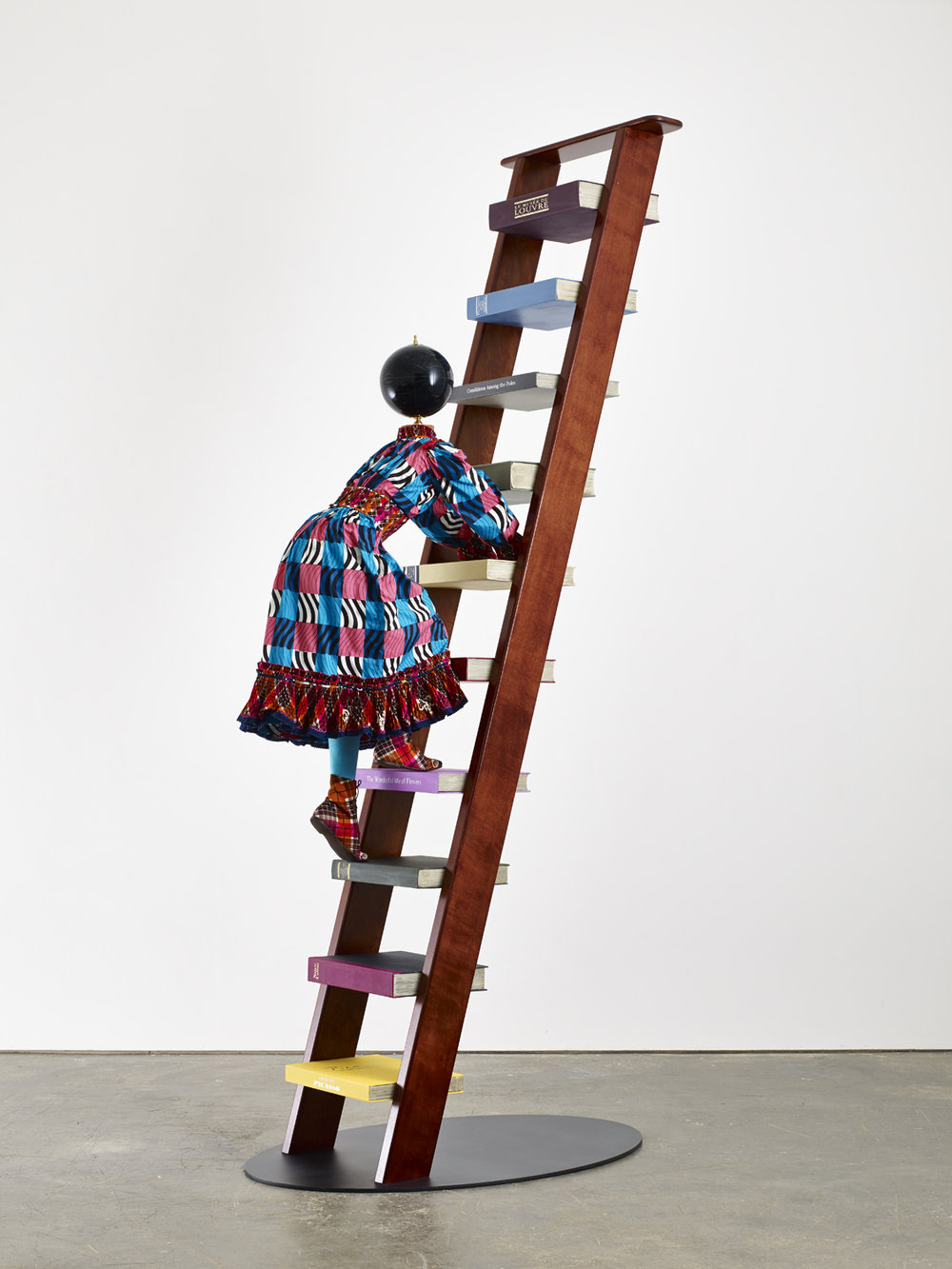Magic Ladder Kid IV 2014, Mannequin, Dutch wax printed cotton textile, leather, fiberglass, wooden ladder, steel baseplate, globe 115 x 55 x 32 inches