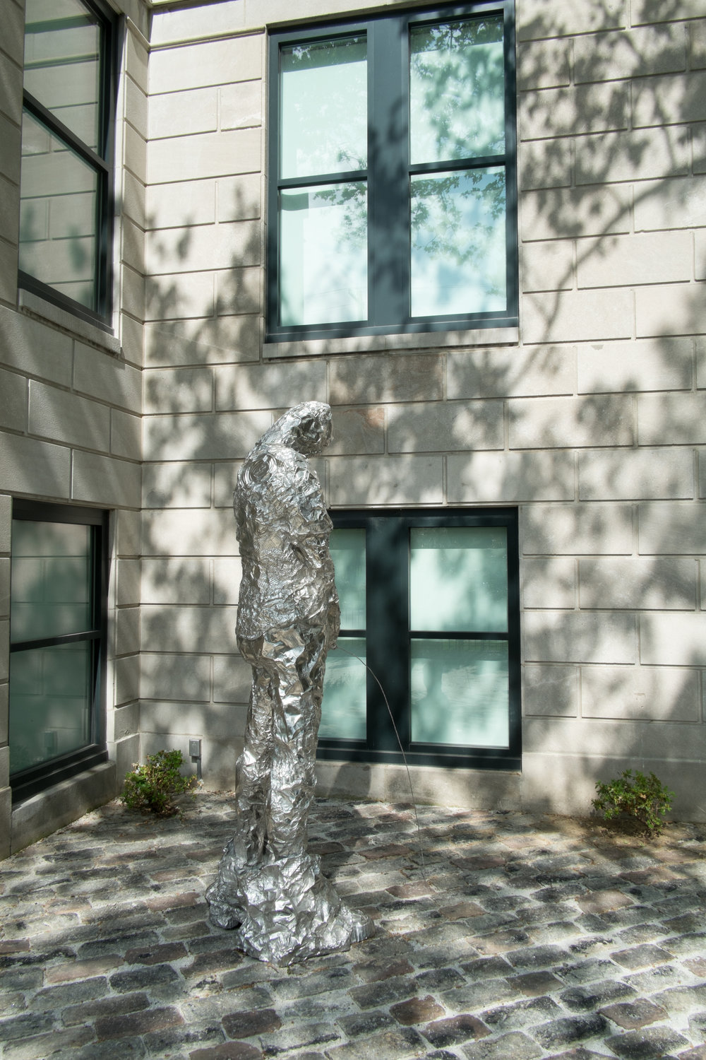 Untitled (Peeing Figure)  2012, Stainless steel cast from aluminum foil and oven roaster tins  96 x 30 x 27 in.