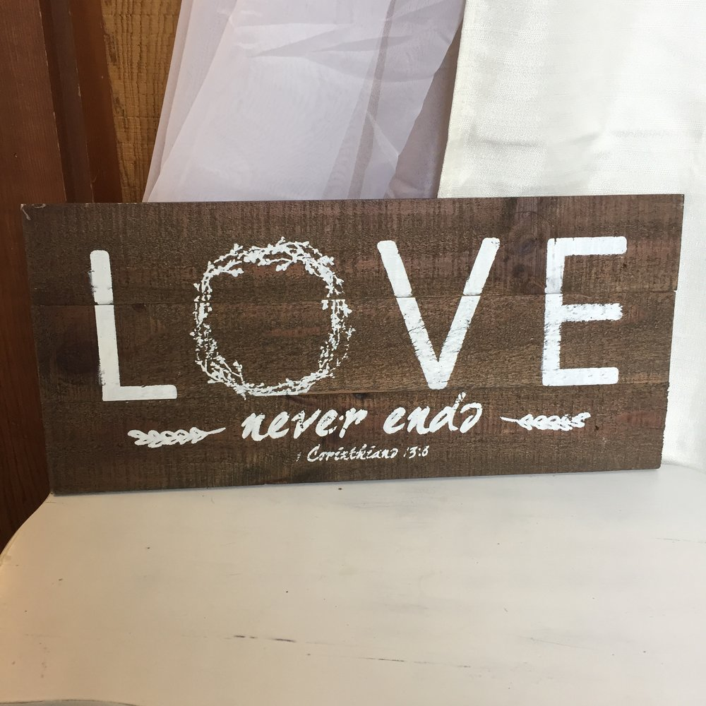Love Never Ends wood sign