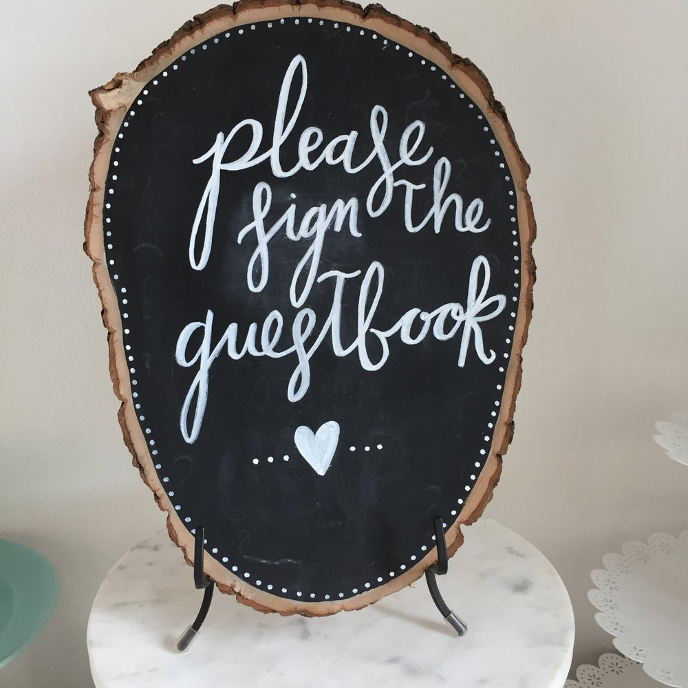 Wood round guestbook sign