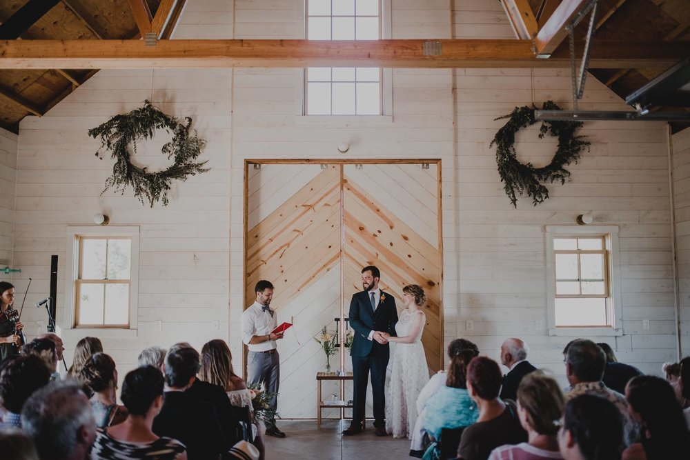 My second wedding in July was Jenna and Joe, they were married at the Croft Farm on Sauvie Island in Portland and although it was SUPER hot that day, it was such an incredible day. They decided to move their outdoor ceremony into the barn which ended up being absolutely adorable and kept everyone out of the heat. I adored how they chose to stand together on one side with their officiant on the other, I thought that was so sweet and unique! Photo by  Kyle Carnes Photography