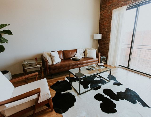 Fiddlefig. Tan leather couch. Cowhide. Exposed Brick. Its like the millennial hipster's checklist of home items. 😉 If you're looking to buy or sell, would love to chat to help you find your dream home or investment property!  wingardrealty.com  #atlantarealestate #atlantarealestateagent #discoveratl #loft #intownliving #homesforsale #dreamhome