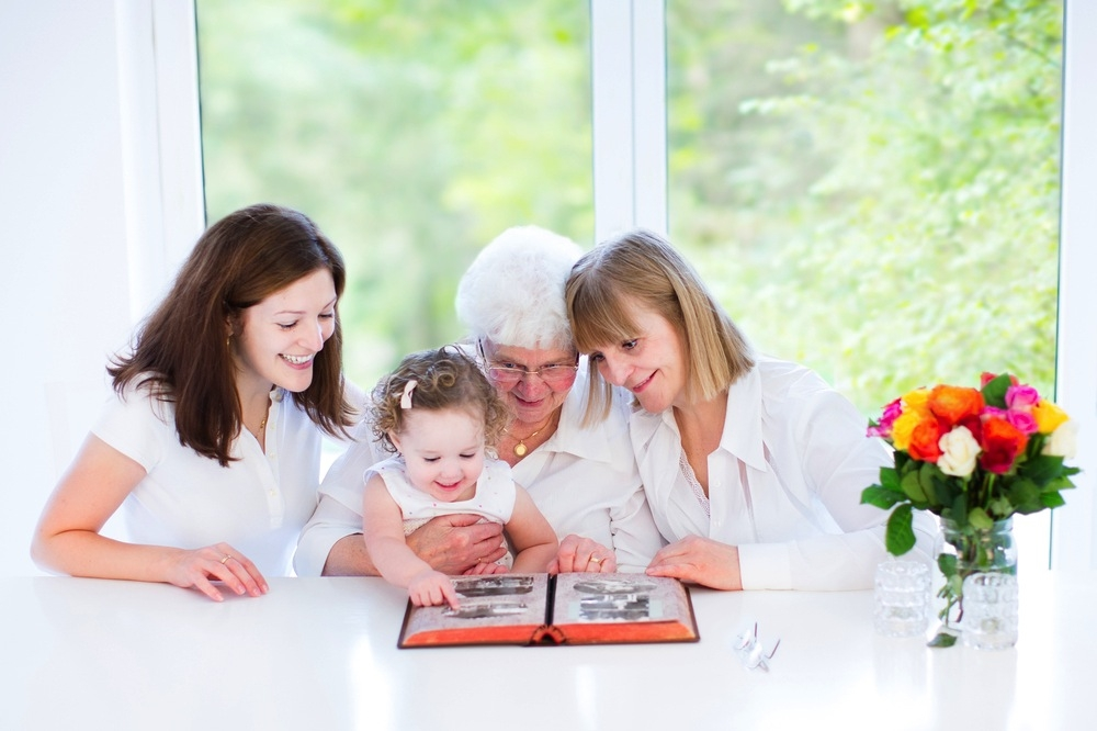 4-generations-looking-at-photo-album.jpg