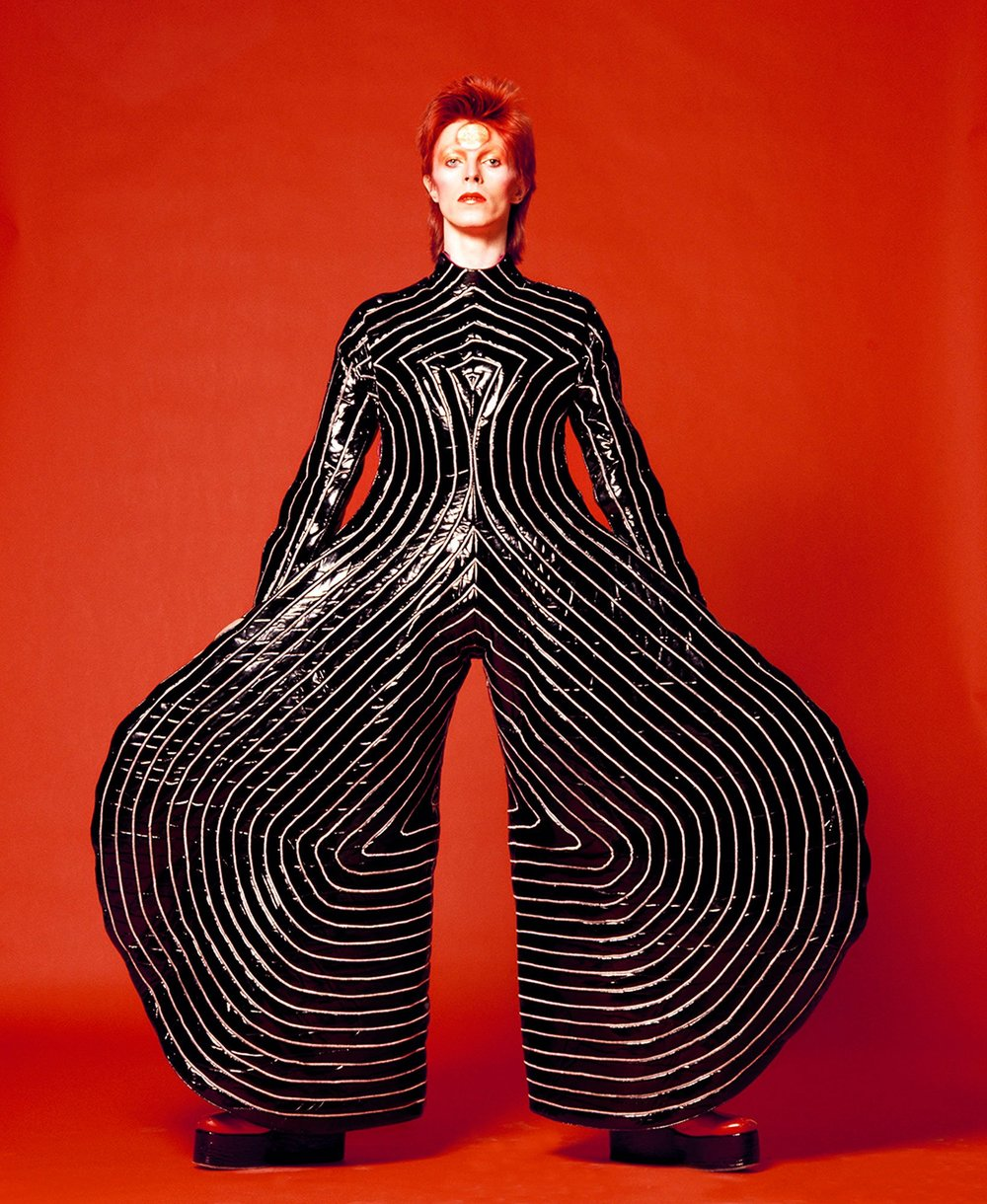 David Bowie 1973. This classic shot contrasts colors versus the black and white line work accentuating the curves of the outfit.