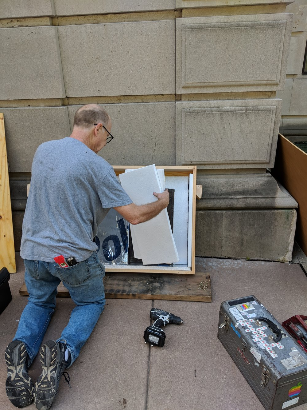 Removed windows are carefully transported to the studio, and a temporary filler is installed into the window frame.