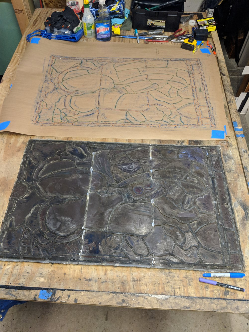 We lay out the panel on the workbench and make a rubbing of the leadwork, so that we can put it back together quickly and precisely. Broken pieces are counted and lead size is noted.