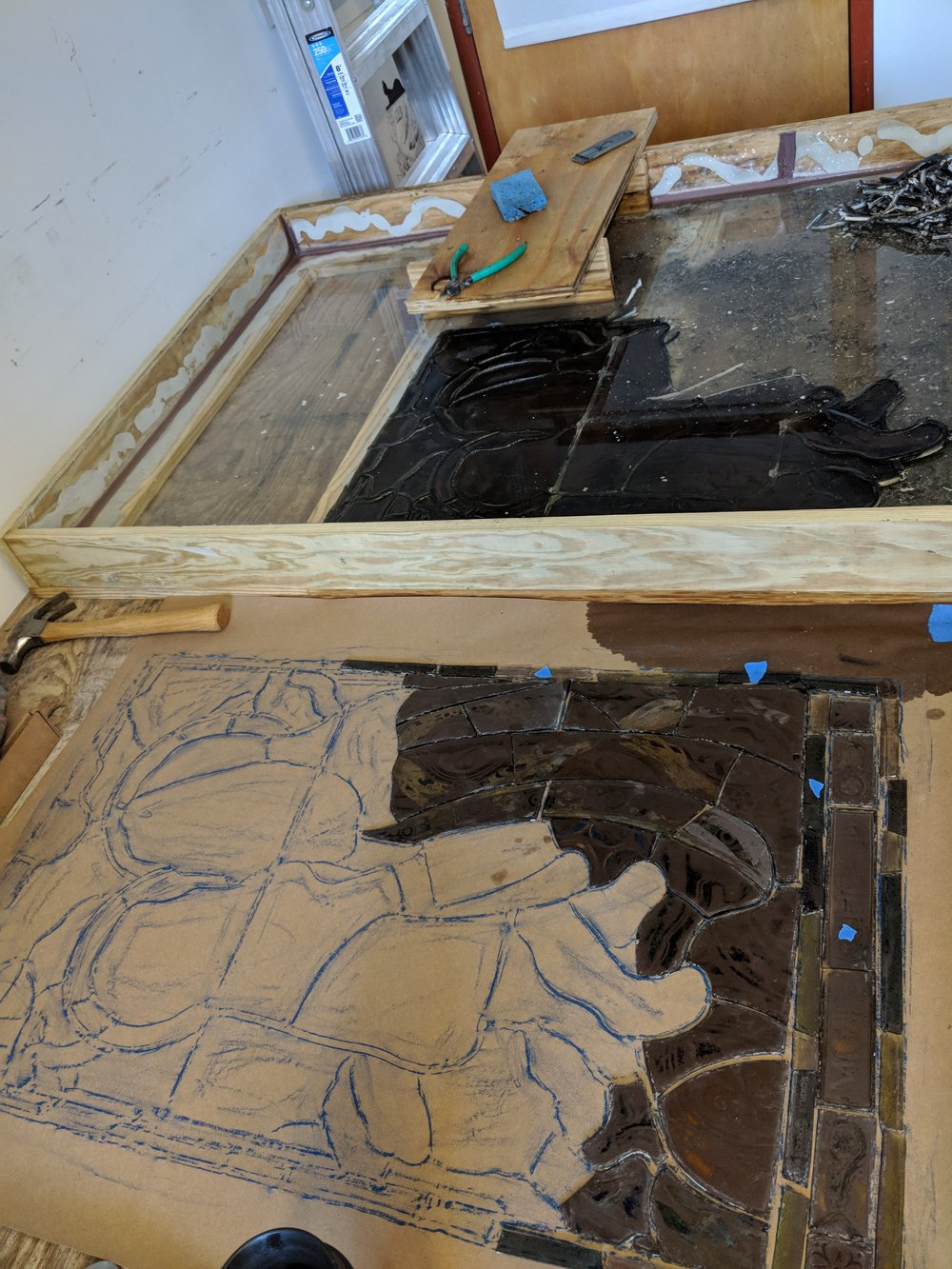 The panel is then taken apart piece by piece, the old lead is disposed of and the glass is carefully cleaned.