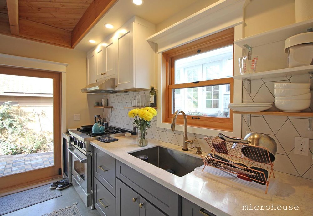 The kitchen is located along one wall is both compact and simple.